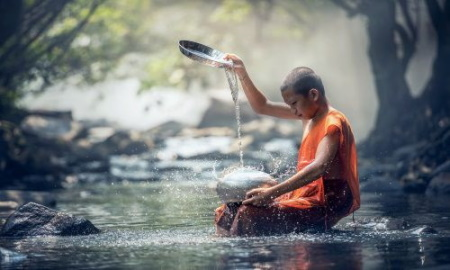 monk pouring water